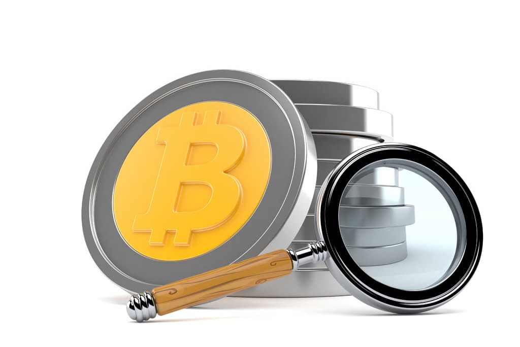 Bitcoin with magnifying glass isolated on white background